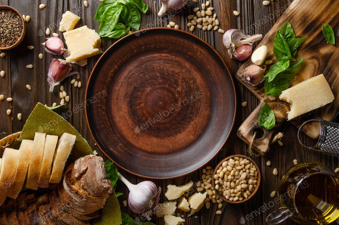 Genovese pesto sauce ingredients on wooden kitchen table with copy-space