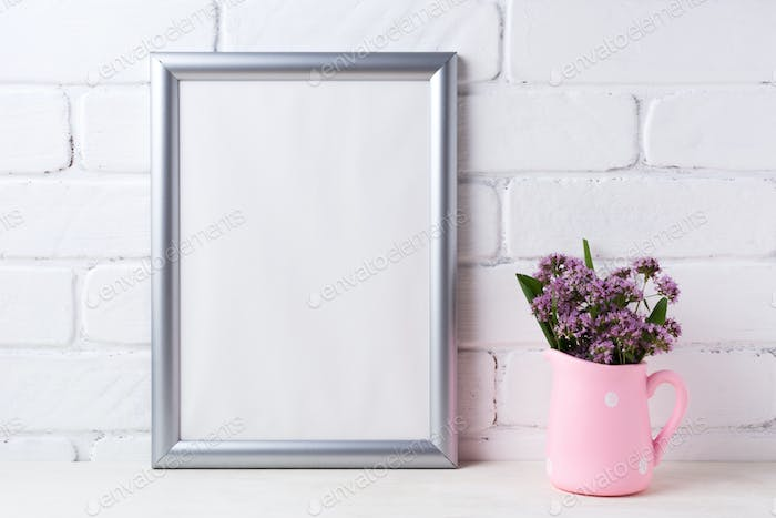 Silver frame mockup with purple flowers in pink rustic pitcher
