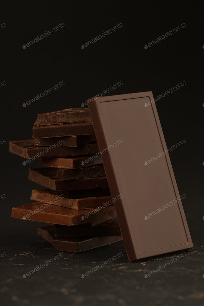Square shaped chocolate pieces on dark background