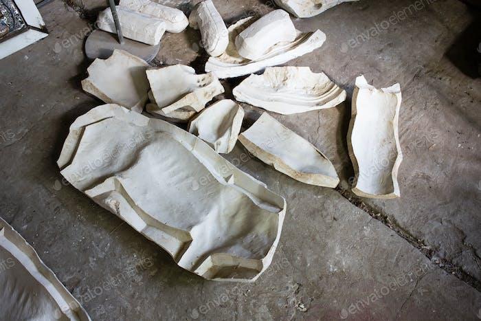 Broken plaster blanks.