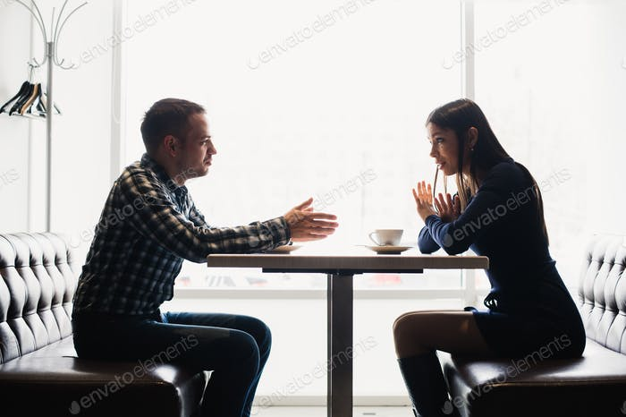 Scene in cafe - couple conflict arguing during the lunch.