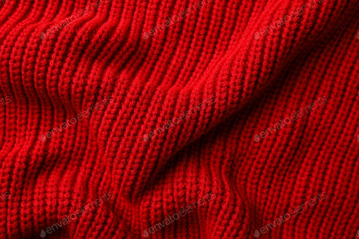 Red sweater texture background, space for text
