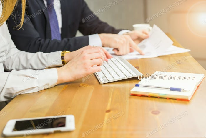 Technology, business and people concept - Woman's hand typing on keyboard