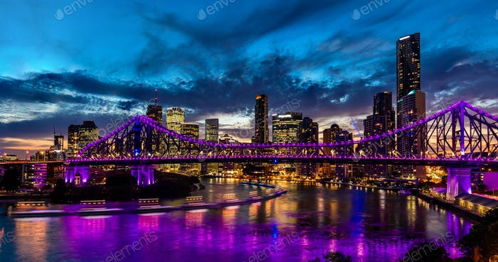 Vibrant night time panorama of Brisbane city with purple lights