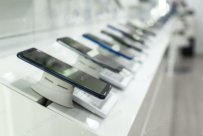 Smartphones on shelf in the store. Concept for communications an