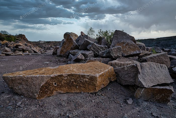 Stone materials near old flooded stone quarry