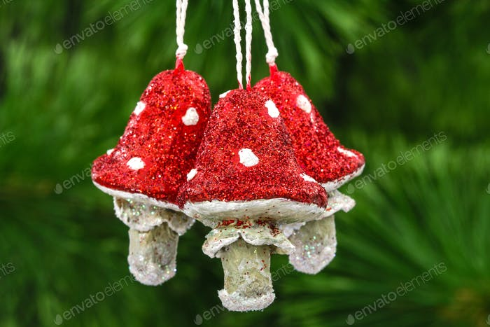 Mushrooms amanita, vintage decoration on a Christmas tree backgr