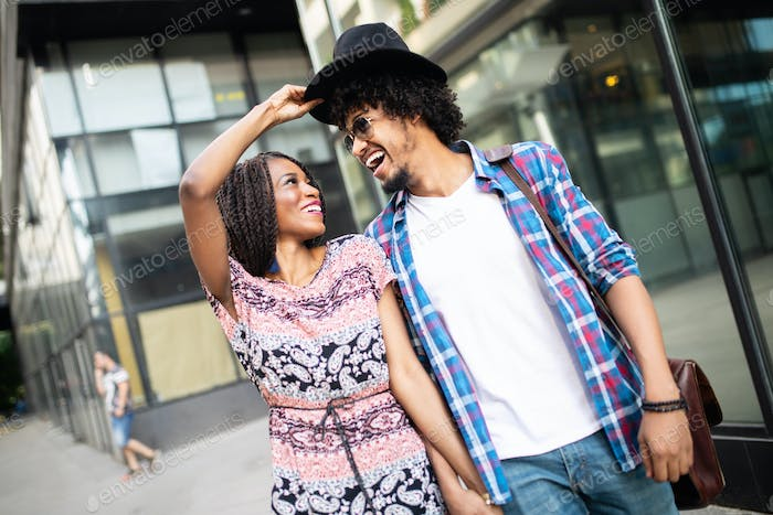 Beautiful young couple enjoying in good mood in city. Lifestyle, love, dating, vacation concept