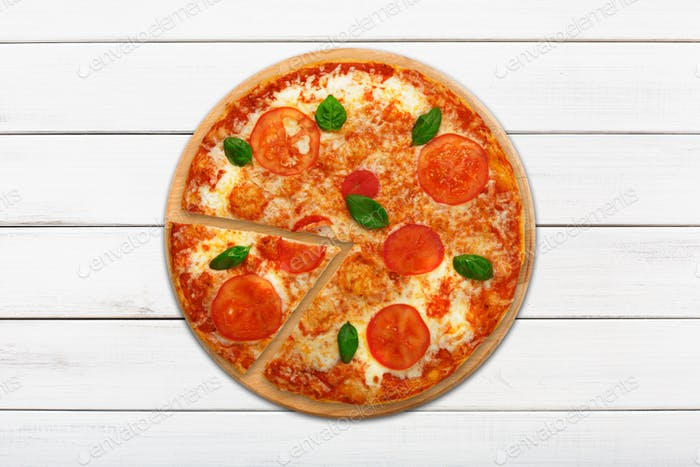 Delicious italian vegetarian pizza Margherita top view at wood