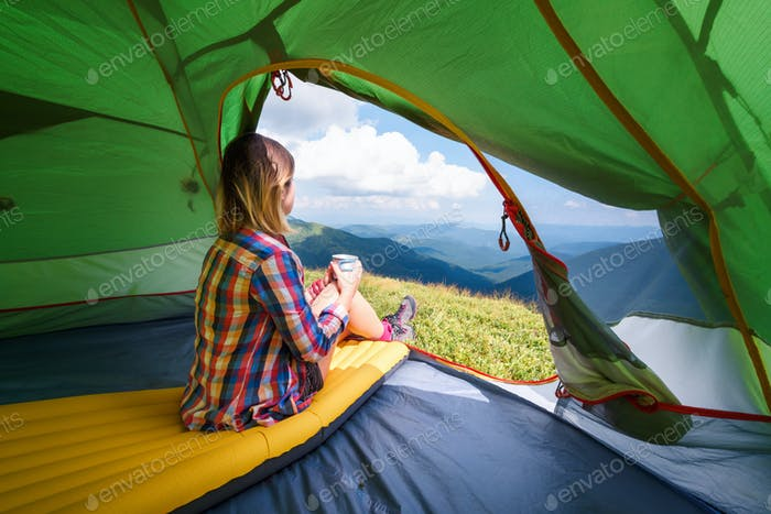 Girl sitting in they tent