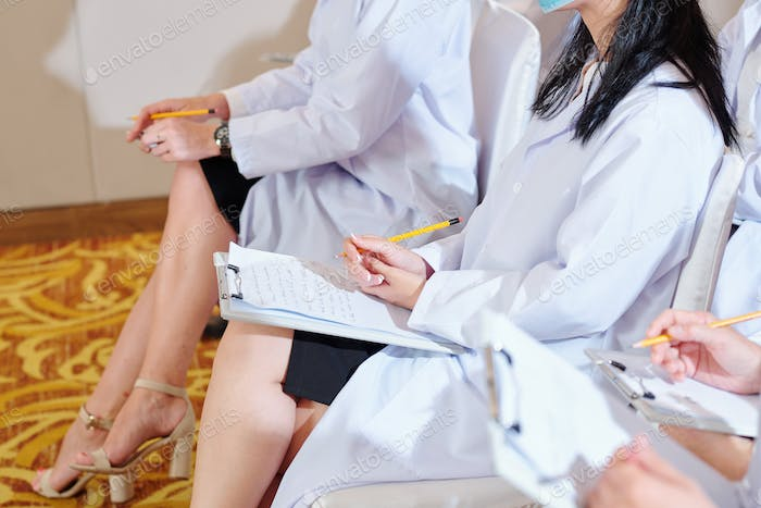 Female doctor attending conference