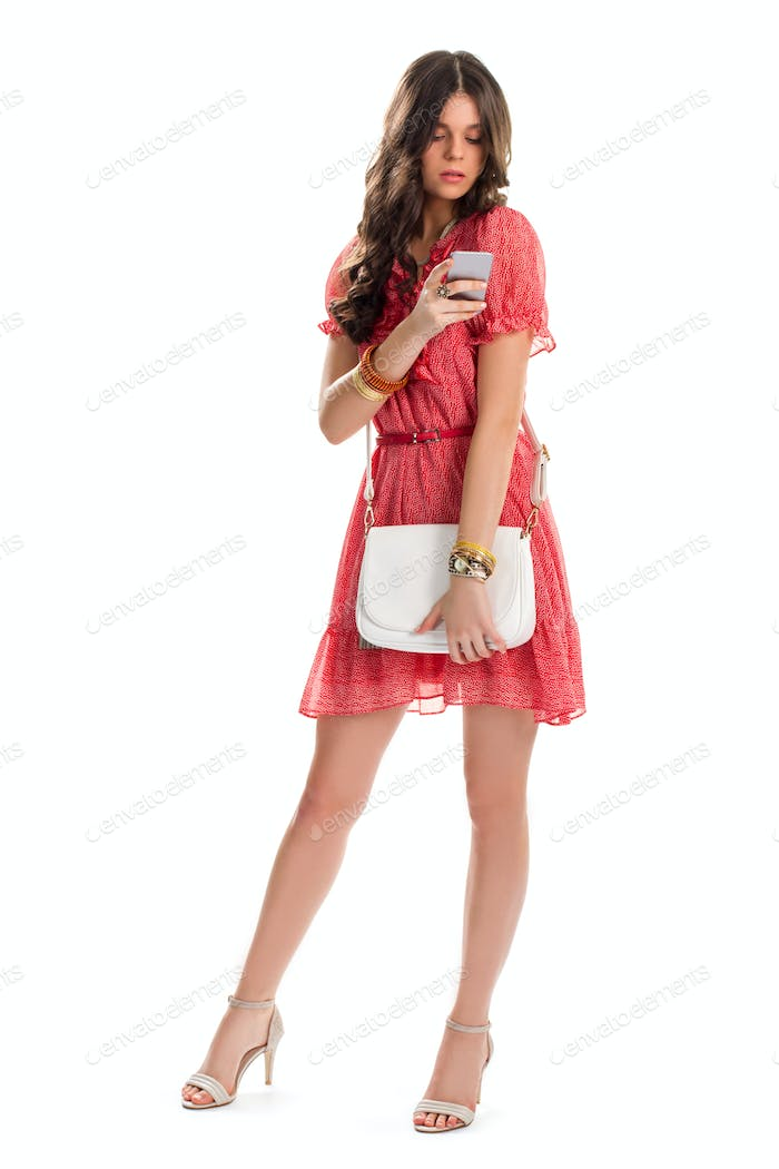 Lady in dress holds phone