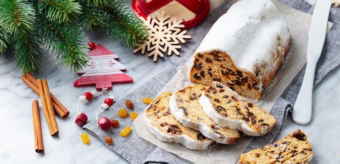 Christmas stollen. Traditional German festive dessert. Marble background