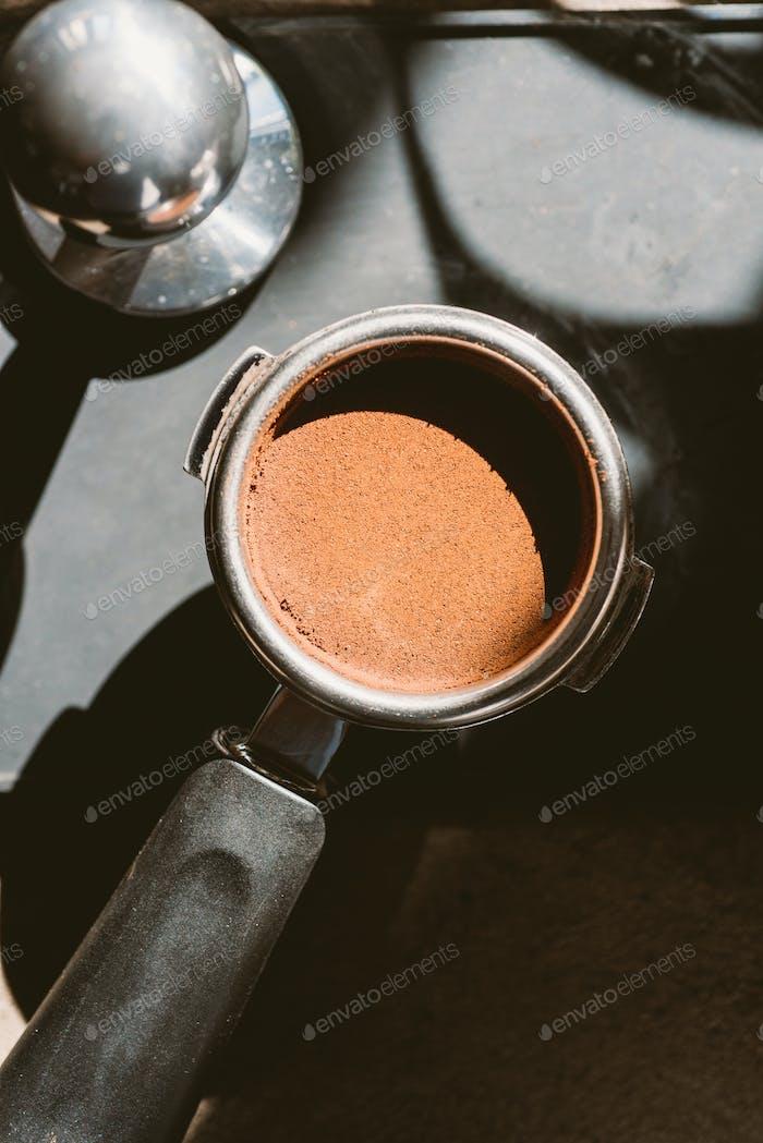 Ground coffee in portafilter
