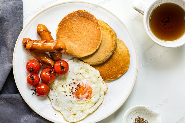 Pancake with Fried egg,Sausages and Cherry Tomatoes