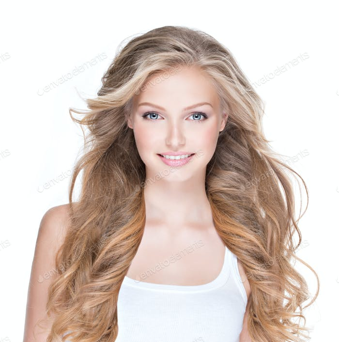 Beautiful happy woman with long curly hair.