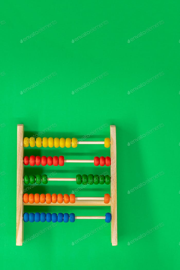 Abacus for calculations on a green background