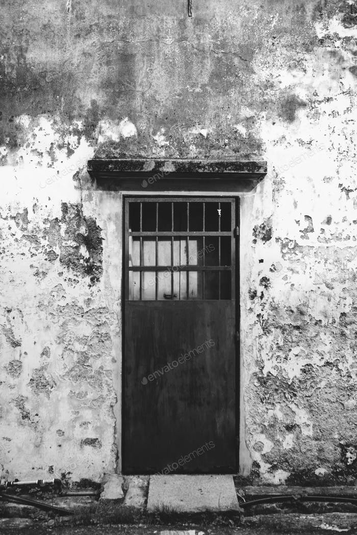 Rustic door and exterior of a house in Penang
