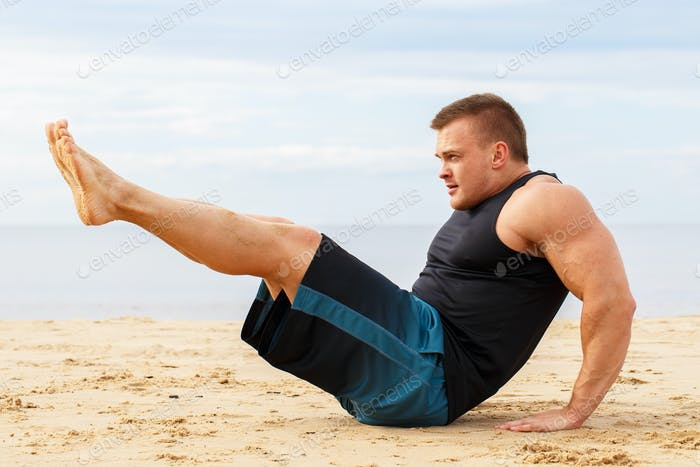 Bodybuilder on the beach
