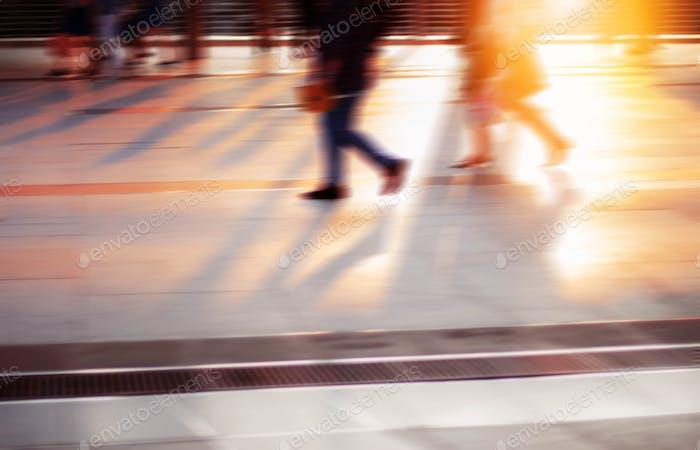 People walking at sunset