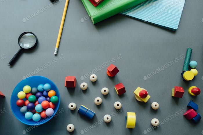 High angle view of scattered beads and toy houses