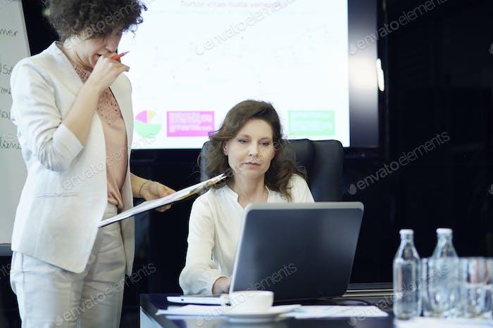 Two business women having meeting