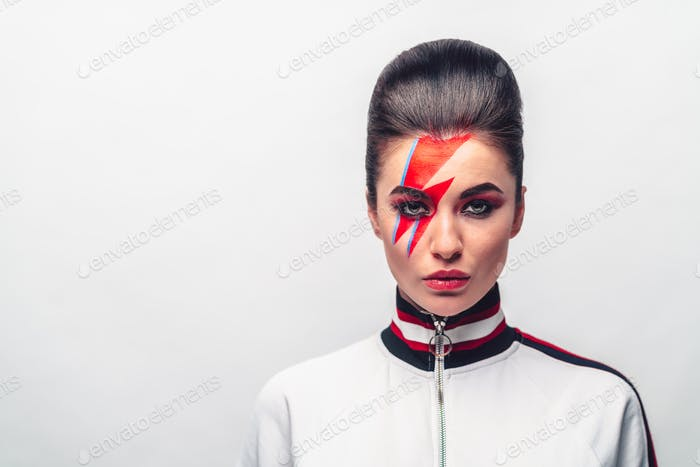 Beautiful young with art make-up