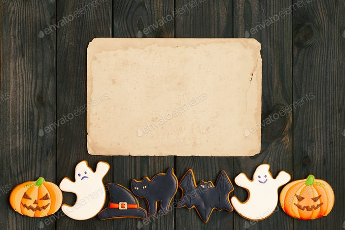 Halloween invitation over wooden background