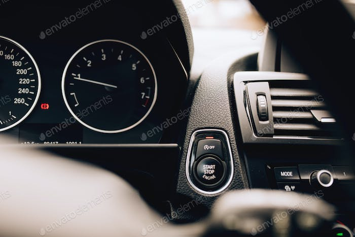close up car interior with start engine button details. modern electric hybrid car