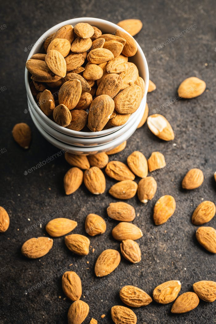 Dried almond nuts in bowl.
