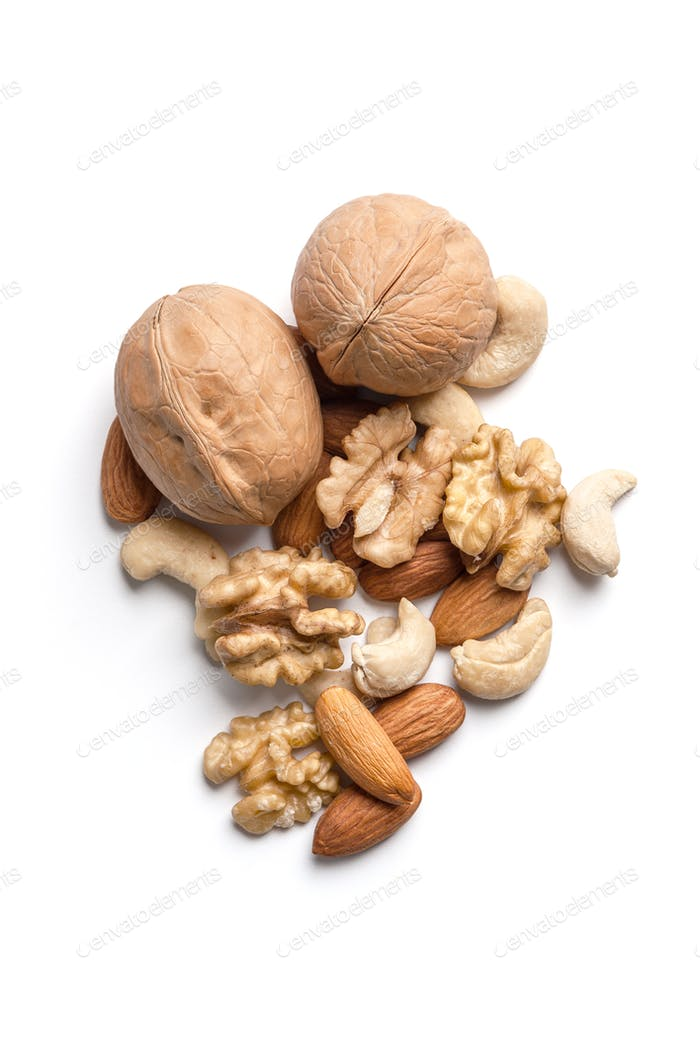 A mixture of nuts on a white background is isolated.