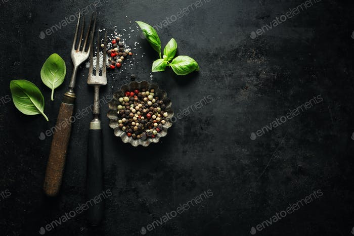 Vintage old rustic cutlery on dark background