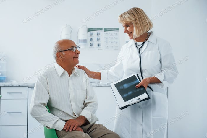 Senior man have consultation in the clinic by the female doctor
