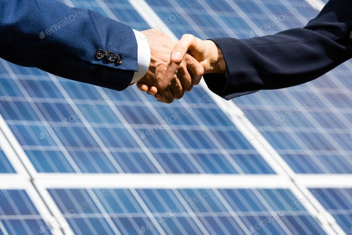 cropped view of businessman and businesswoman shaking hands outside