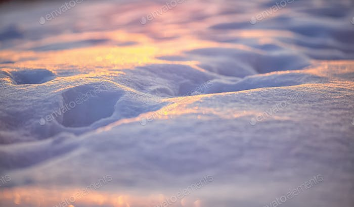 Natural winter background with snow drifts at sunset