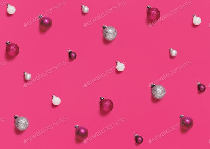 Christmas baubles on a pink background
