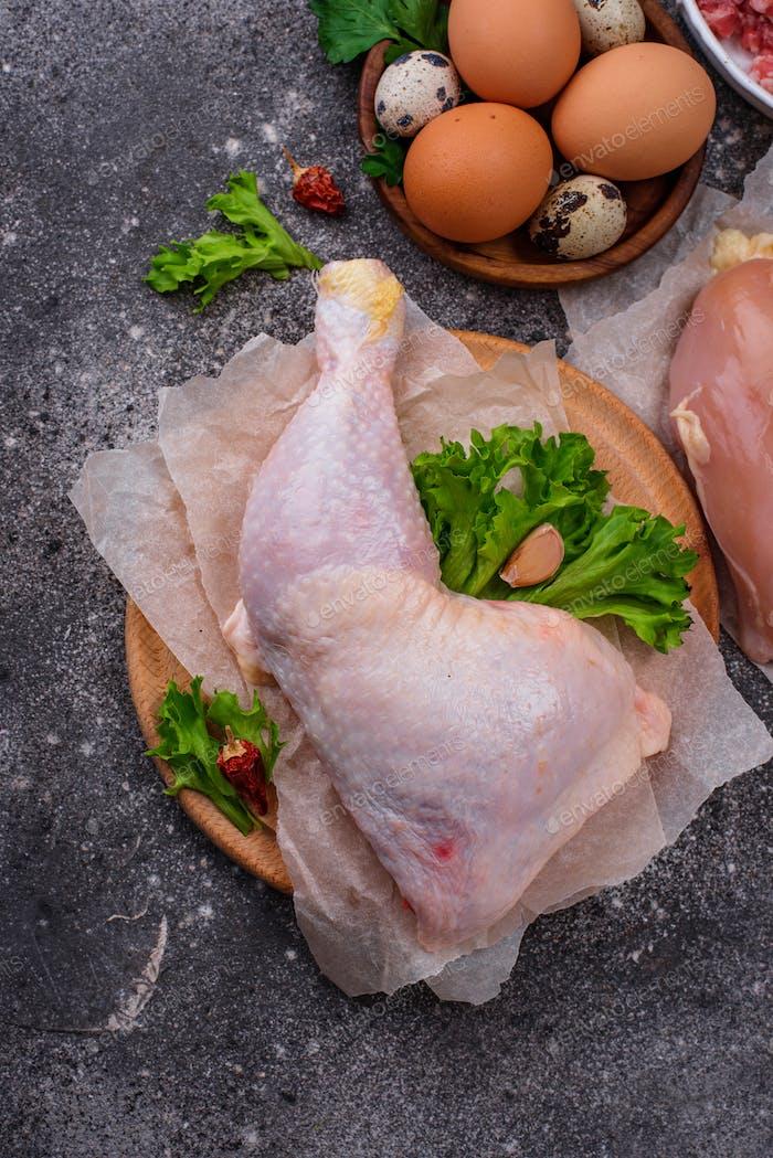 Raw chicken leg on cutting board