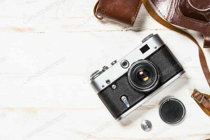 Old film camera on white background