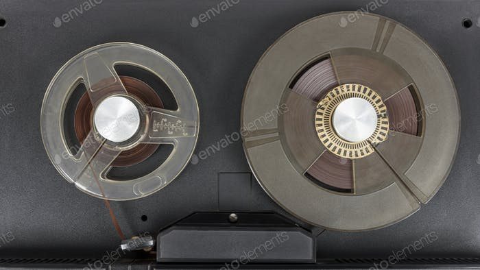 Reels of old audio tape in tape recorder