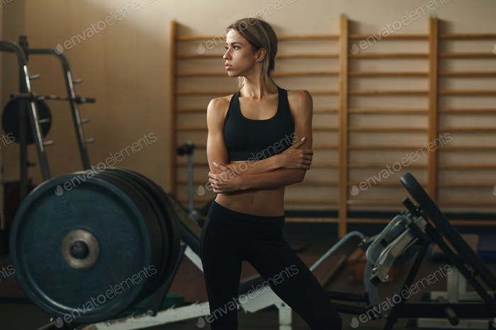 young woman fitness training in brutal gym interior