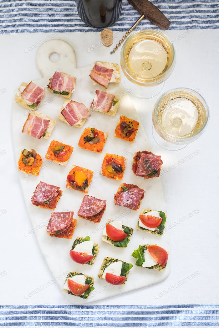 selection of antipasti tapas served with wine