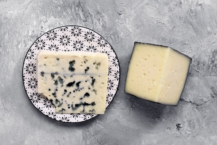 take from above two pieces of gray marbled cheese