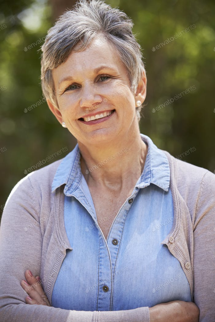 Outdoor Portrait Of Mature Woman With Folded Arms