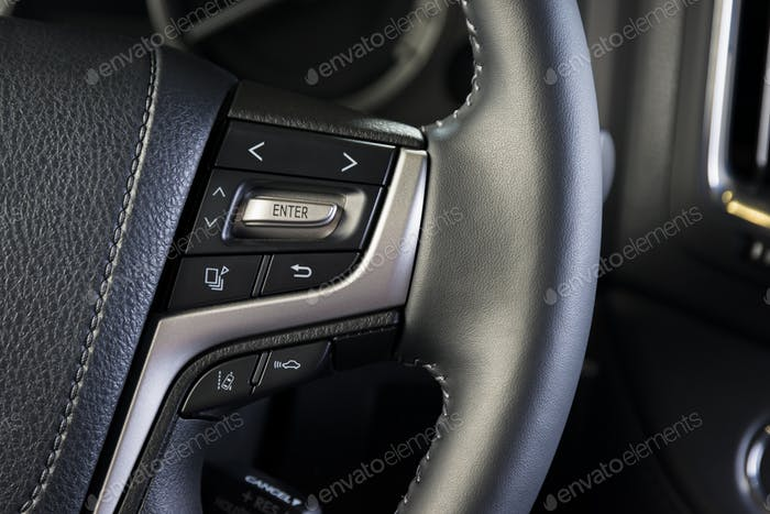 Media buttons on the steering wheel, car interior details
