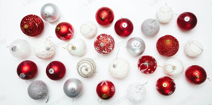 Xmas baubles flat lay against white background