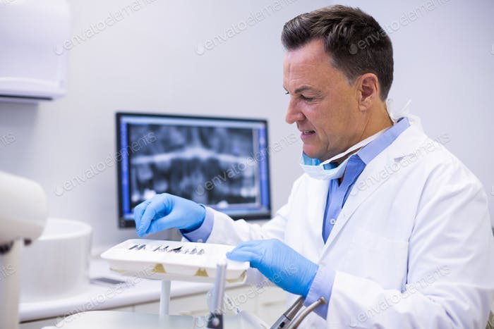 Dentist checking tools in dental clinic