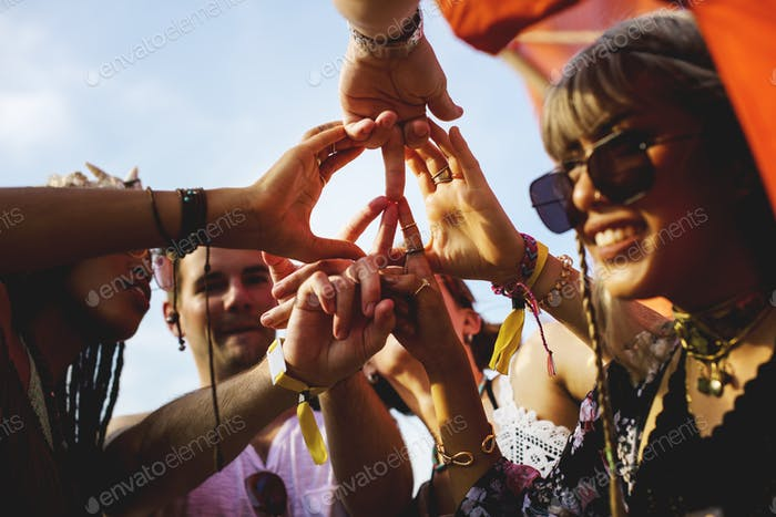 Friends Making Hands as Peace Sign Together