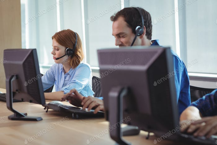 Business people working on computer at call center