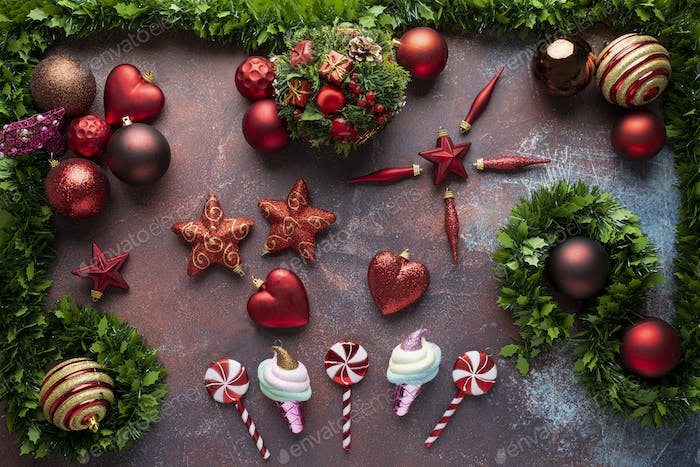 Christmas background with baubles, stars, lollipops and fir tree