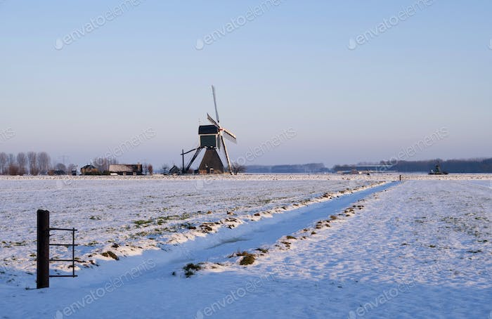 Windmill in a snow covered landscape